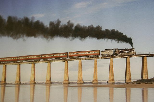 Outeniqua Choo-Tjoe ( South Africa) : Old romantic steamlocomotive on bridge along the Indian Ocean, near Mosselbaai and St. George in South Africa;  photo by dirk huijssoon, via Flickr