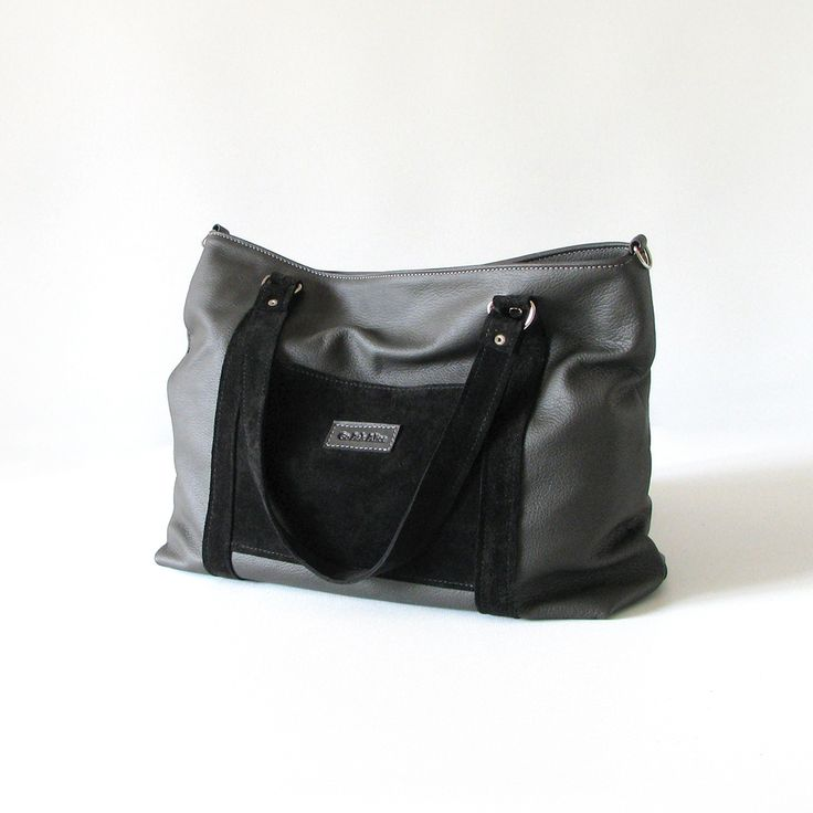 The Big Betty tote is handmade from soft charcoal cowskin leather with black jersey suede detailing.