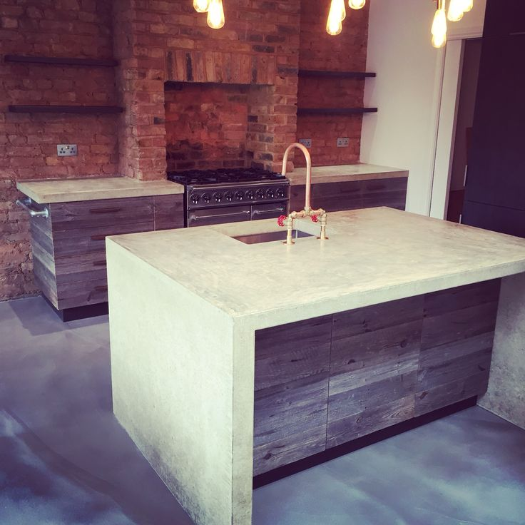 Arnold's kitchens: Kitchen designed constructed and installed in London with reclaimed barn sidings, polished concrete worktops and island. This was cast in-situ as one stand alone piece. arnoldskitchens.co.uk