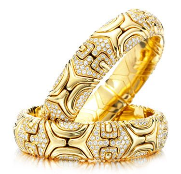 a pair of diamond and gold cuff bracelets by bulgari circa
