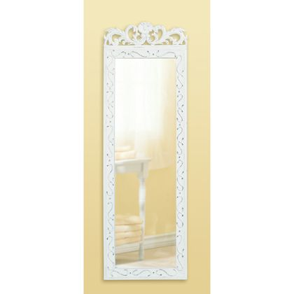"""Carved floral designs and """"shabby elegance"""" styling make this a distinctive wall mirror that will add character and beauty to any home. Wood in distressed white finish. 9 7/8"""" x 1/2"""" x 30 1/2"""" high."""