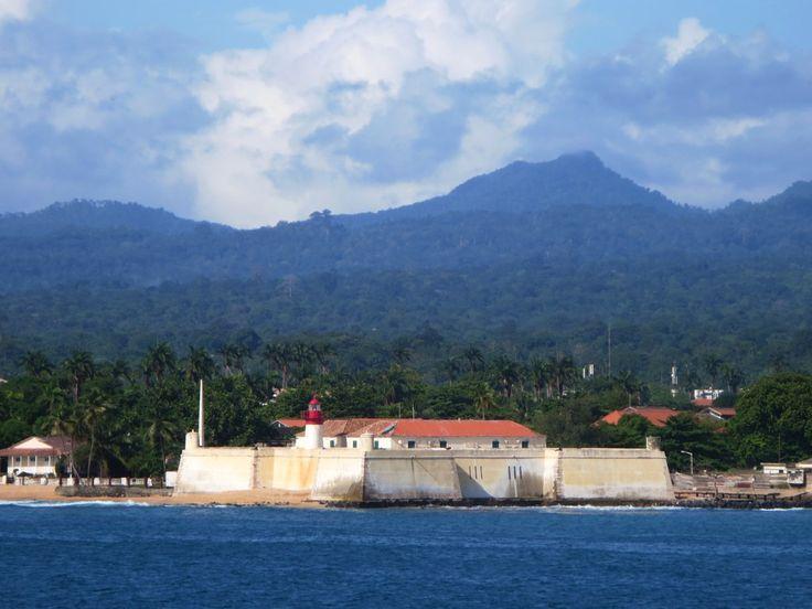 The verdant peaks of São Tomé Island provide a backdrop for the Forte de Sao Sebastiao (1575) in São Tomé town, São Tomé and Príncipe.