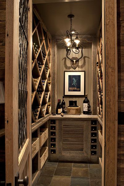 It's not every mountain retreat that can claim a wine room of its own as well as a wine chiller tucked into the kitchen island. This room incorporates the salvaged barn wood used throughout the kitchen and adds a little color with a slate tile floor.