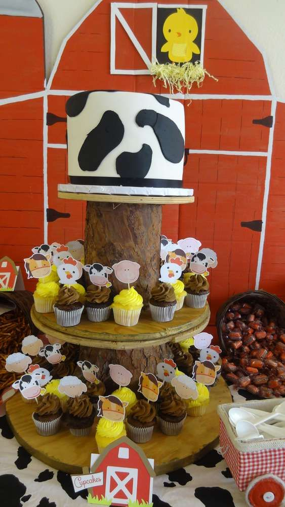 Cow cake and cupcakes at a farm themed baby shower party! See more party ideas at CatchMyParty.com!