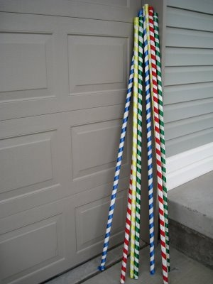 Carousel poles for a circus themed party made with pvc pipe and coloured ribbon.