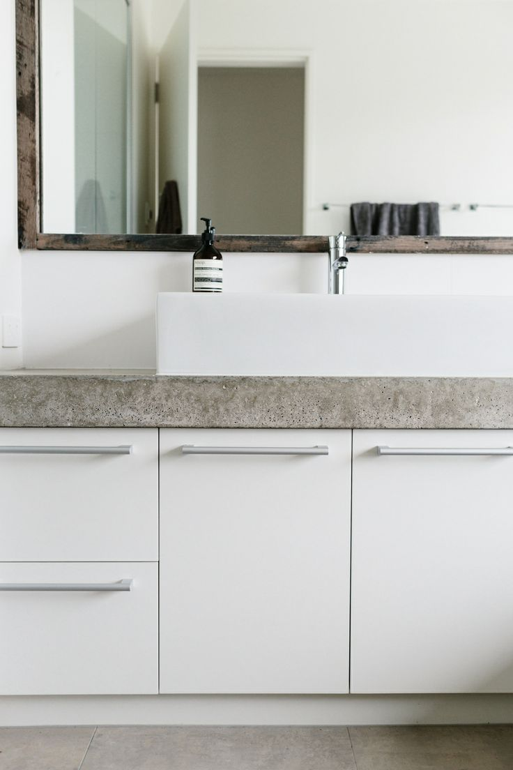 Concrete in the bathroom...form & function Photograph by Tara Pearce Photograghy Styled by Stephanie Somebody