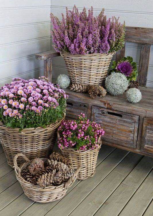 creative potted flower display on front porch using baskets