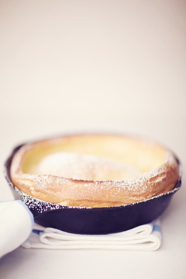 Dutch baby pancakes are like a hybrid (or a love child, if you will) of a pancake, a crepe, and a popover — all in one giant skillet. It feels like a party trick, but for the breakfast crowd. I break these out whenever anyone in my house needs a little extra delight in their day.