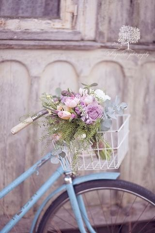 Blue bike with lavender flowers