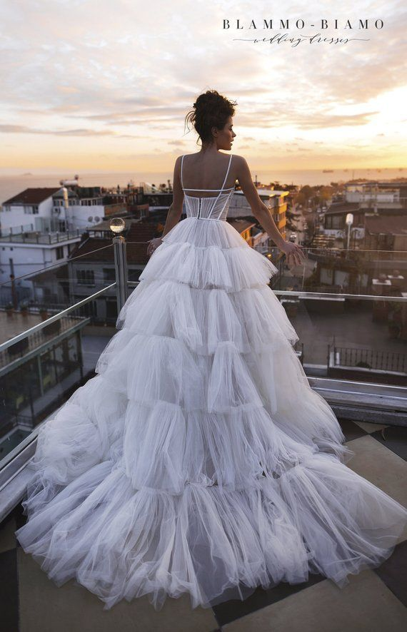 Haute Couture A-line wedding dress with pearl flowers and lace fabric