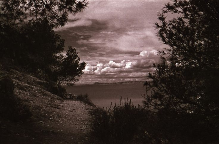 https://flic.kr/p/Hcqtkw | Puffy clouds desde la cala mallaeta.. (Allicante , Spain) | A Rainy day in the month of April. Red filter used 50 mm zuiko lens and developed in Caffenol C. HP5 400 FILM