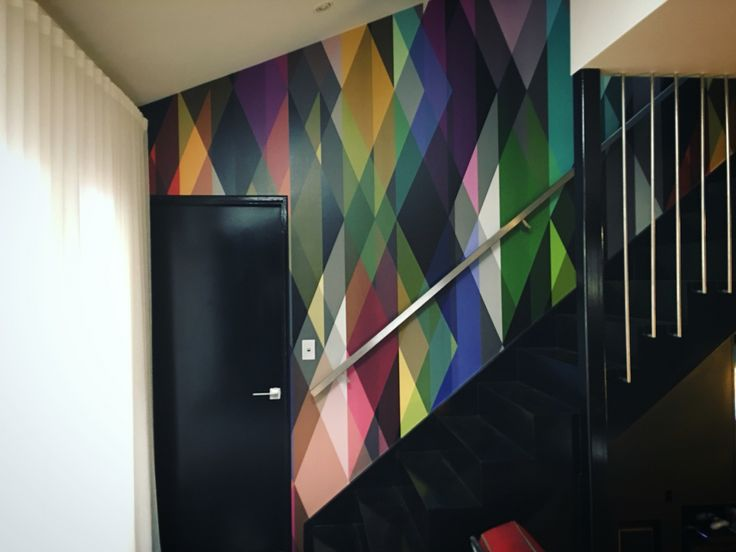"""Black stairs, cole&son """"circus"""" wallpaper, white sheer curtains"""