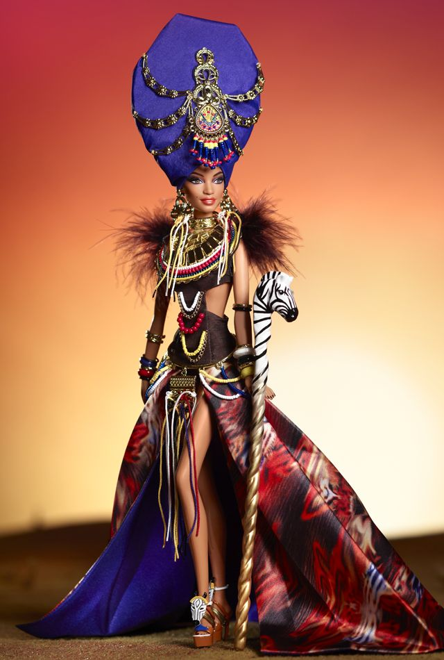 Tribal Beauty Barbie by Linda Kyaw. The first doll in the Global Glamour Collection shows her exotic side wearing an intricate ensemble featuring a feathered midriff top, golden breastplate adornment, waist-attached bead fringe, earrings, bangles, long split skirt and elaborate headpiece. Her zebra scepter pays tribute to the royal splendor of Africa and her status as a reigning queen of fashion. Look at her shoes!!!