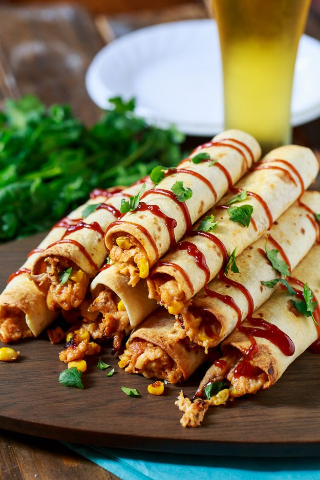 BBQ Chicken Taquitos are filled with shredded chicken, cream cheese, bbq sauce, and corn and baked until crispy.