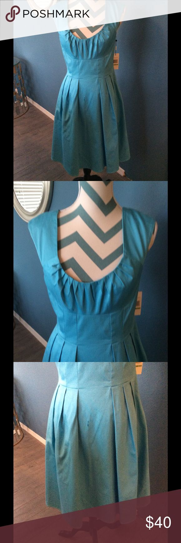 Calvin Klein NWT Dress, SZ 8 Calvin Klein new with tags turquoise cotton dress with the deep V-neck and gather details on the front bodice, an empire waist pleated skirt from the back back zipper fully lined a beautiful dress great for upcoming Easter Calvin Klein Dresses Midi