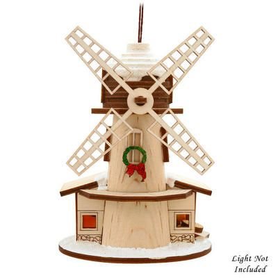 "Artfully crafted in the USA, this charming Dutch Windmill ornament is cleverly crafted of balsam wood with shimmering glitter accents. Featuring a holiday wreath hanging from an upstairs window and a sign reading Vrolijk Kerstfeest - Merry Christmas in Dutch- this imaginative 4½"" tall Ginger Cottage ornament is specially designed to contain a holiday surprise. Simply insert a standard mini-bulb in the base to reveal the secret!"