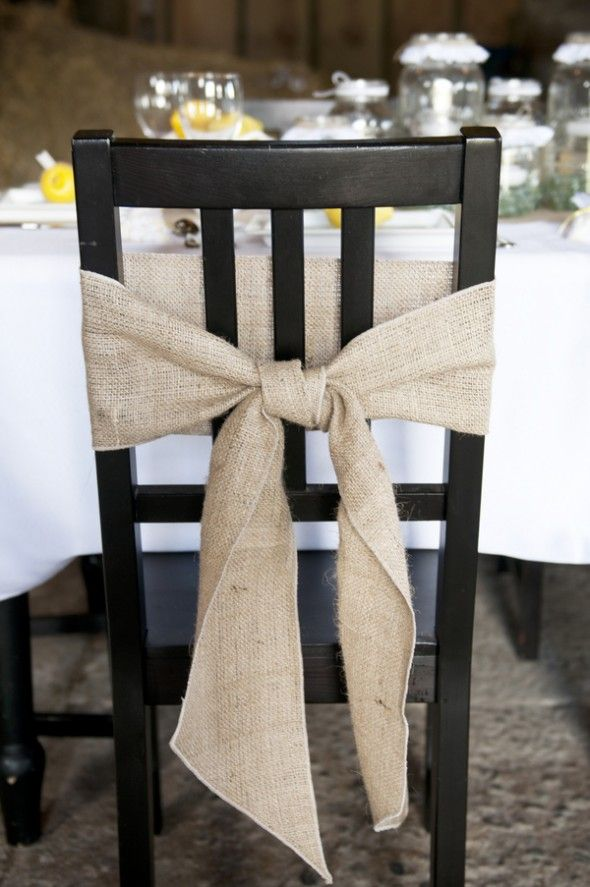 I definitely want wood chairs and the burlap bow just gives it