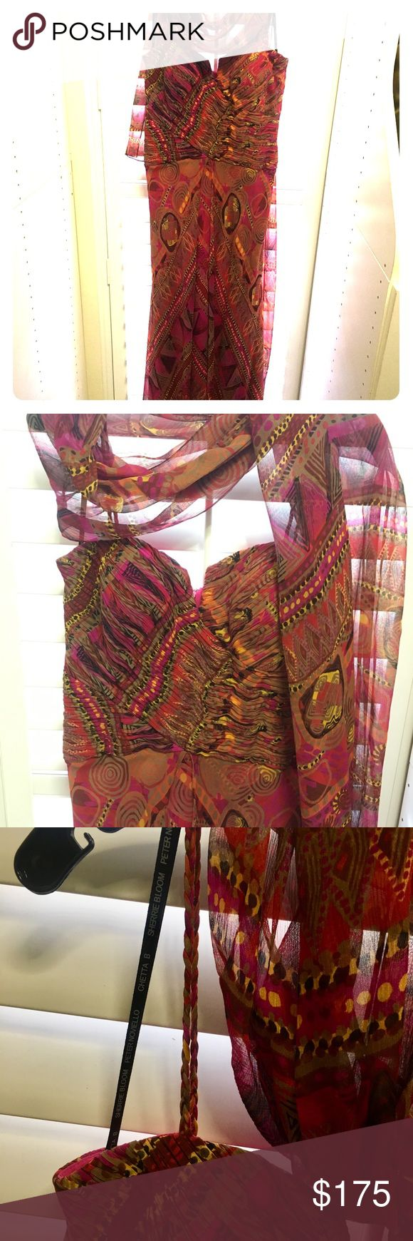 Tribal print long dress by Chetta B Stunning 100% silk, tribal print, long dress. The colors are so beautiful together and unexpected. Browns, fuchsia, golden yellow. Bottom has a separated skirt that gives beautiful, flowing movement. Spaghetti straps are braided from the silk fabric. Comes with matching wrap. CHETTA B Dresses