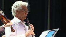 Cabinet minister plays oboe in symphony orchestra