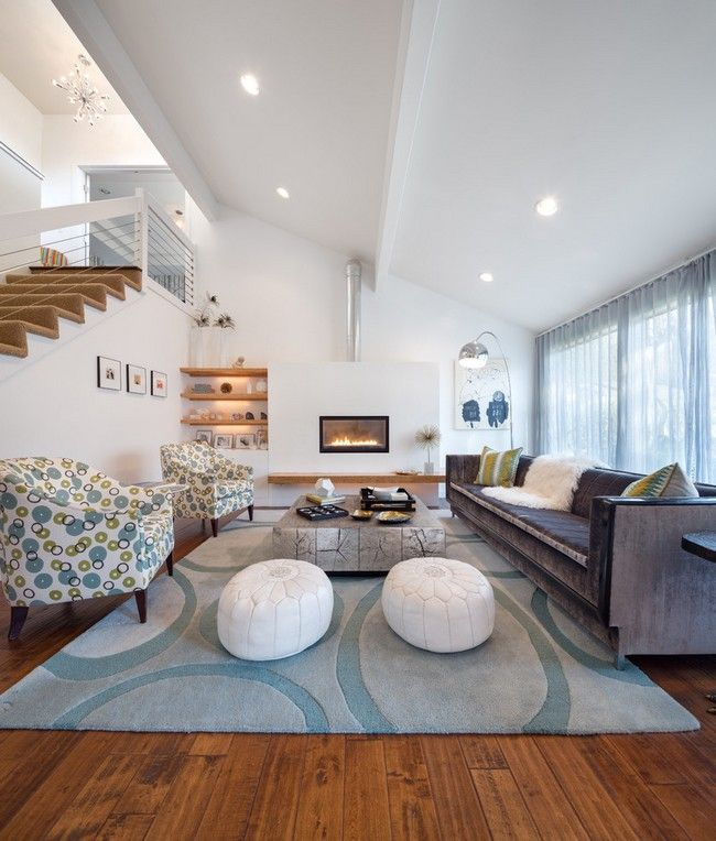Cozy living room with white slanted ceiling, matching the tone of the rest of the room