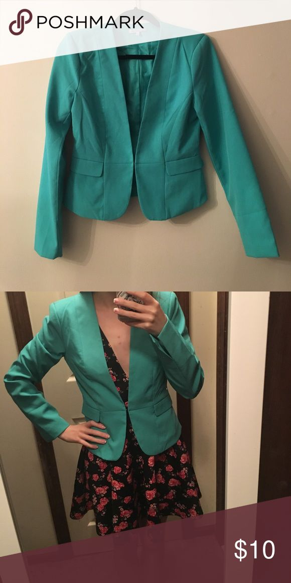 Turquoise Blazer Turquoise Blazer with hook closure. Very cute with a black outfit for work. Charlotte Russe Jackets & Coats Blazers