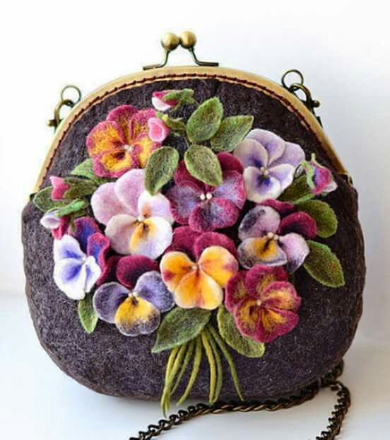 "We're starting a new series looking at needlework on bags and purses - some of the most utilitarian of our possessions.  Catherine Turkova created this very sweet needle felted ""Viola"" purse.  Each of the flower centers is decorated with beads.  You can see more of Catherine's work at http://www.livemaster.ru/item/6264509-sumki-aksessuary-valyanaya-sumochka-viola"