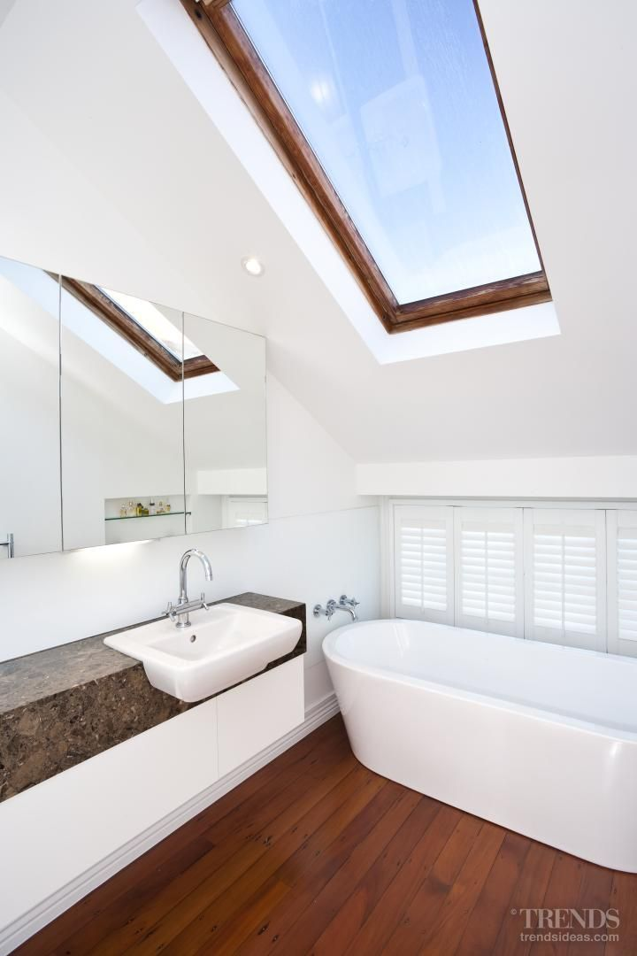Every aspect of this bathroom design by designer Nicola Manning increases the sense of space. Shutters admit sunlight while retaining privacy, while the timber floors and skirting boards match those found in many other areas of the residence. The freestanding tub – often selected for more generous spaces – is a modern interpretation of a classic form, and so was appropriate for the traditional home.