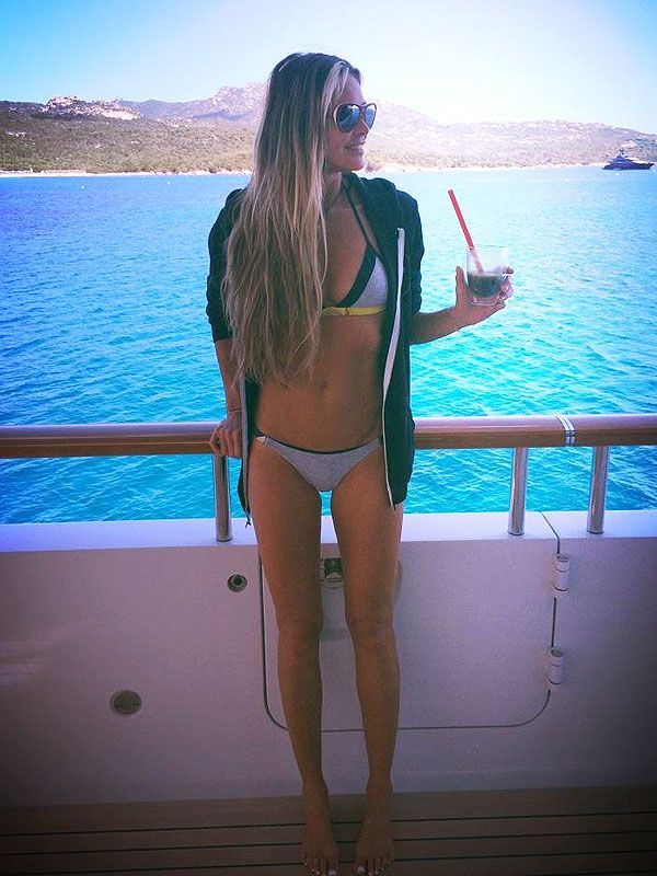 Elle Macpherson's lounging (and looking ridiculously amazing bod at 50). We Remain in Awe | People.com