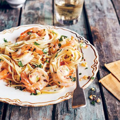 Pasta with shrimp garlic and parsley. For the full recipe and more dinner party ideas, visit Red Online