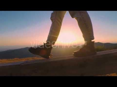 of Boots on Sunset Background (Stock Footage)