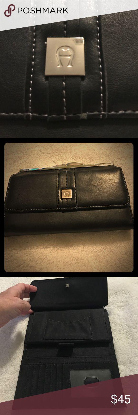 Vintage Etienne Aigner wallet in great condition. Vintage black Etienne Aigner wallet in gently used condition. Etienne Aigner Bags Wallets