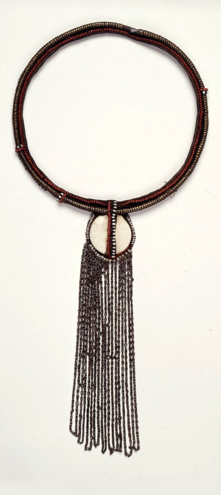 Kenya / Tanzania | Necklace; leather, glass beads, conus shell, iron and brass wire, with chain | Possibly from the Masai people from the Kilimanjaro region or Kenya | ca. 1904 or earlier