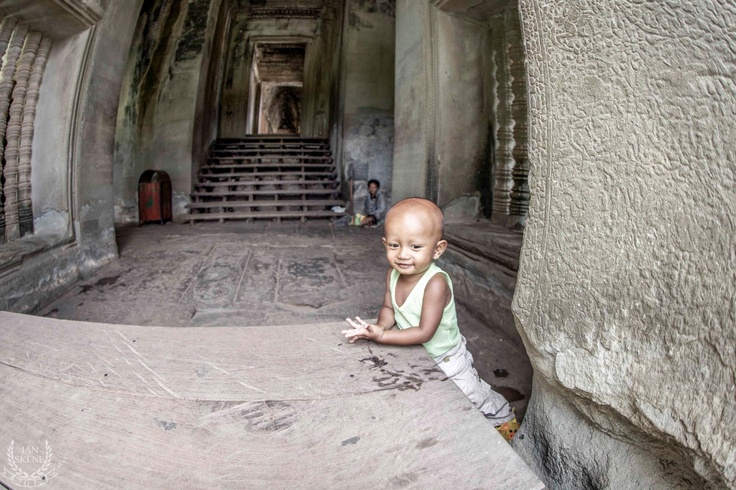 Child Playing in Angkor Wat while mother ask for Donations