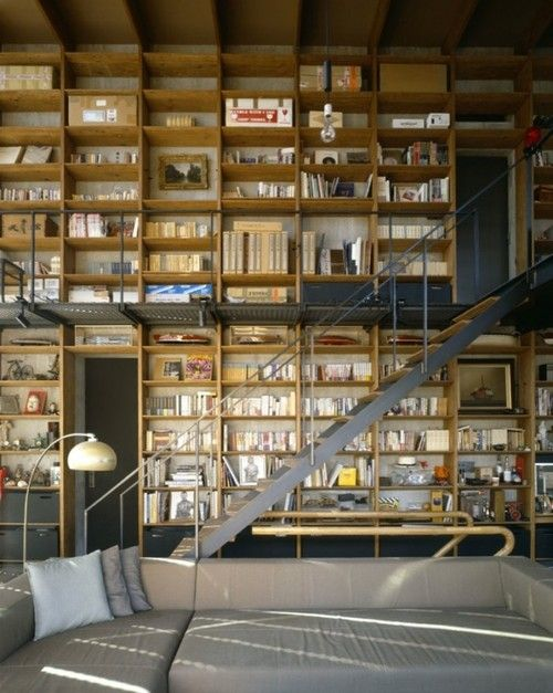 This stylish loft apartment features floor to ceiling shelving
