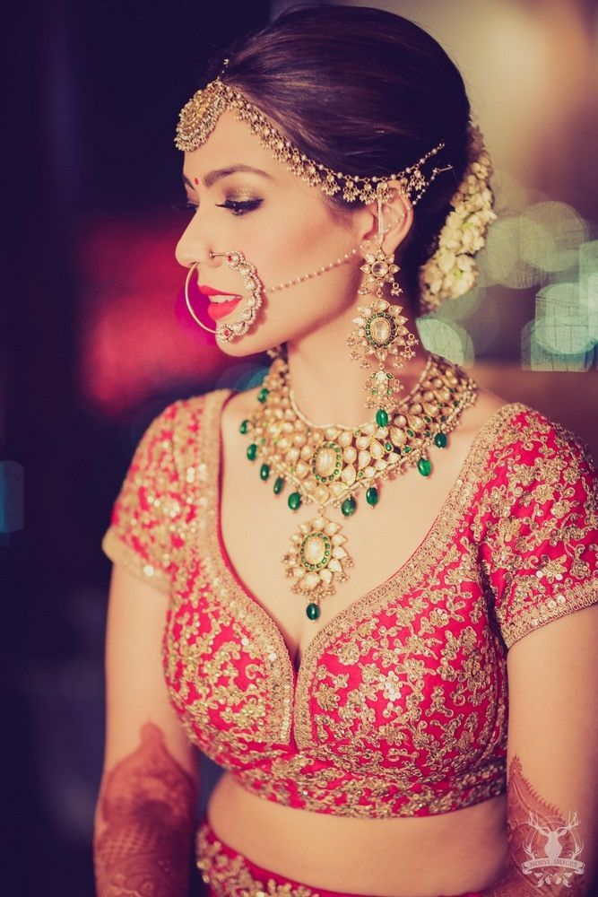 Real Indian Weddings - Arushi and Dhruv | WedMeGood | Polki and Emerald Wedding Jewelry with a Gold and Pearl Matha Patti and a Pearl and Polki Nath, Red Blouse with Antique Gold Emroidery Picture Courtesy: @morviimages #wedmegood #realwedding #indianbride #indianjewelry #lehenga #indianwedding #red