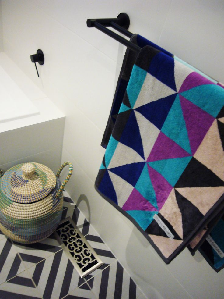 Review Interiors - Bathroom renovation. Geometric towels and tiling.