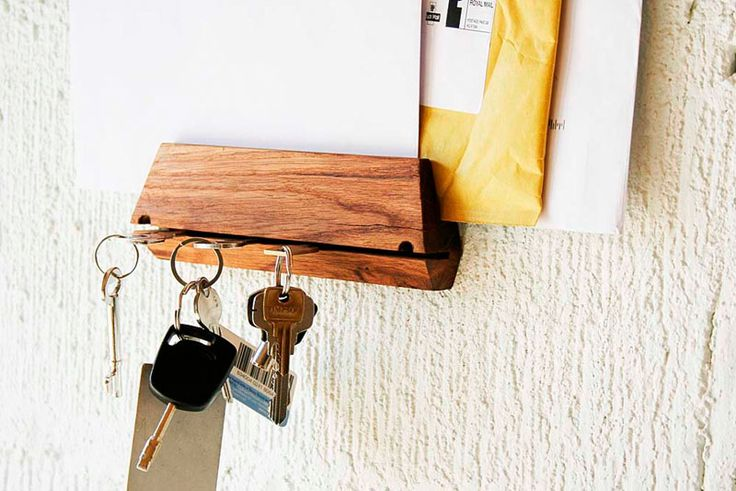 16 Key Holders To Keep You Organized // A thin cut in this wood block is just big enough to tuck a key into and has a mail slot perfect for helping you stay organized.