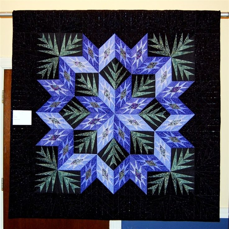 """Beautiful quilt design. never saw it on black background before, makes the blue """"Pop"""""""