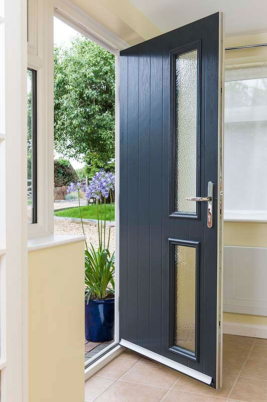 Anthracite grey classic GRP door with chrome furniture and obscured glass panels