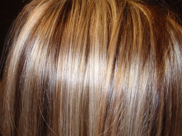 Dark Brown Hair With Blonde Streaks | this is a cool highlighted hairstyle with blonde streaks gracing the ...
