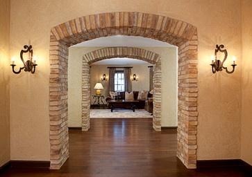 Traditional Home Tuscan Design,   Love the stone arches by Details Interiors, LLC via houzz.com