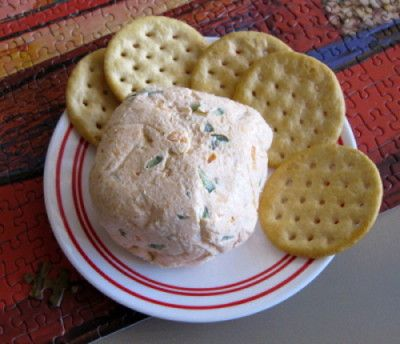 Quick easy party cheeseball recipe – Snappy Living  This is a cheeseball recipe you can throw together in just a few minutes. It looks and tastes like you've gone to a lot of trouble. Normally, I would roll it in chopped nuts, but I didn't have them on hand today. You can put it down in a decorative bowl or dish and serve it that way, or just like this. Recipe 1 cup of finely shredded cheese – cheddar or cheddar jack. 4-6 ounces of soft cream cheese 2 tablespoons of finely chopped...