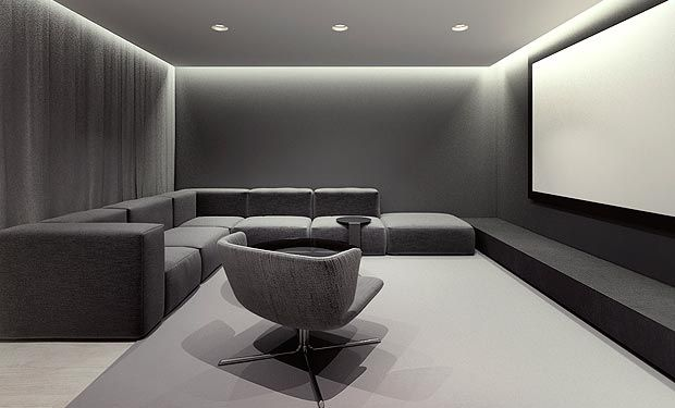 Inspiration for Abrahama/Bonnie's modern home design: Customize gray sectional/ black leather chair/ cove lighting