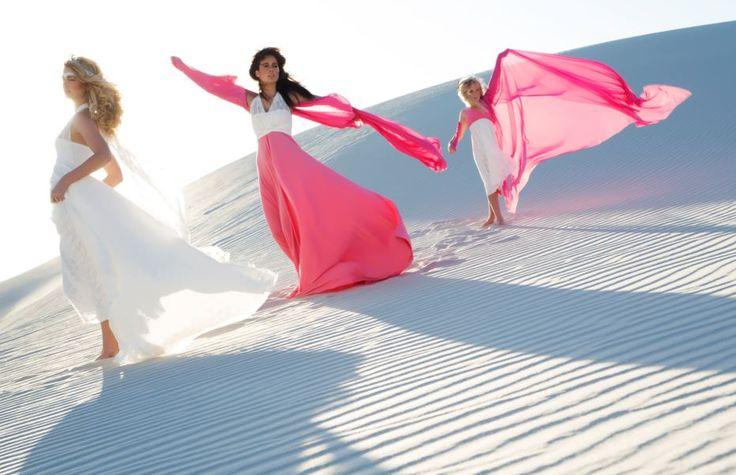 Infinity bridesmaids dress with lace top and full length pink skirt; Infinity flower girl dress with pink straps and calf length skirt with lace overlay.#weddings #infinitydress #wrapdress