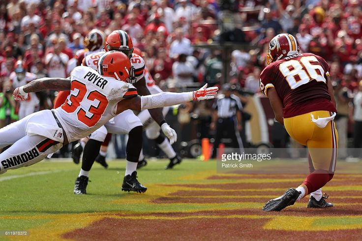 Tight end Jordan Reed #86 of the Washington Redskins scores a first quarter touchdown past free safety Jordan Poyer #33 of the Cleveland Browns at FedExField on October 2, 2016 in Landover, Maryland.