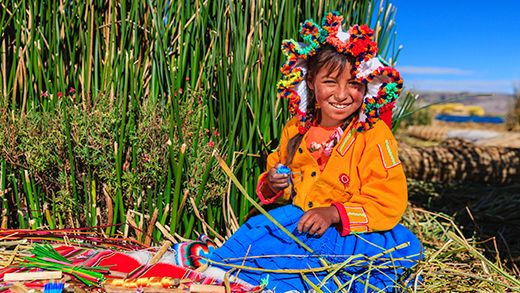 Smiling local girl by Lake Titicaca in Peru #Kilroy #backpacking #travel #locals #people #smiles