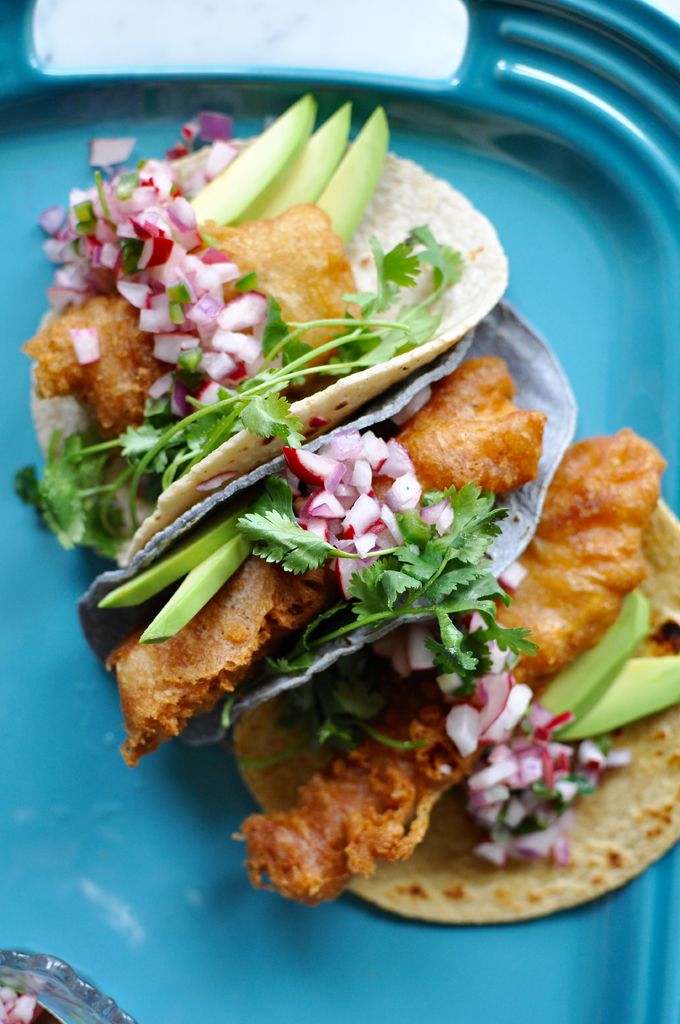 Beer-battered crispy fish tacos recipe topped with a crunchy radish pico de gallo, avocado slices, and a squeeze of lime. Dairy free! | ¡HOLA! JALAPEÑO