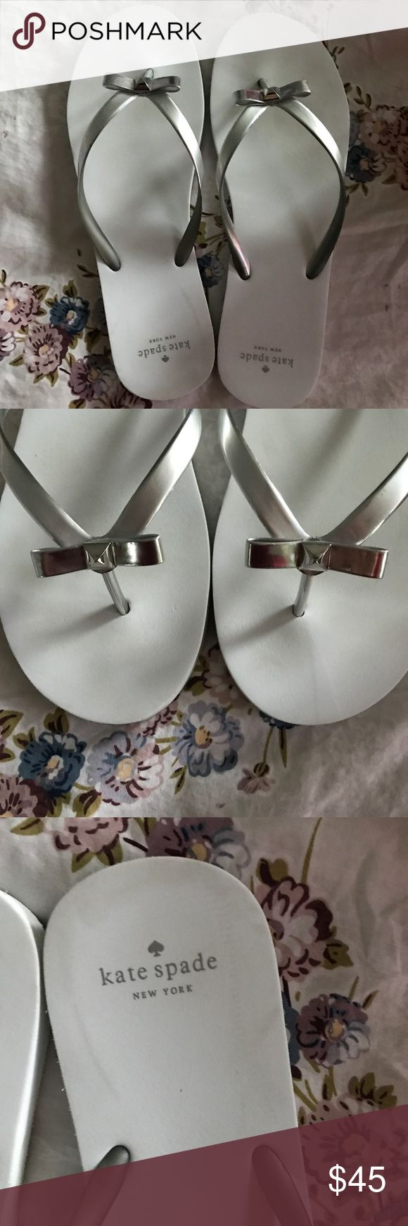 Kate Spade Happily Ever After Flip Flops Only worn twice on my honeymoon. Minimal wear from it as seen on the bottom. Extremely comfortable. Cute bow detail and imprints happily ever after when walking in the sand. Comes with box and silk bag. Perfect for a bride! kate spade Shoes Sandals