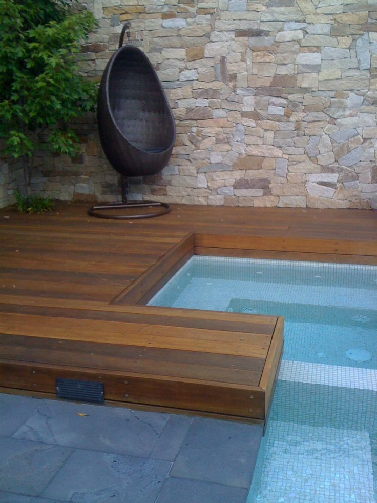 Alpine stone wall and spotted gum deck