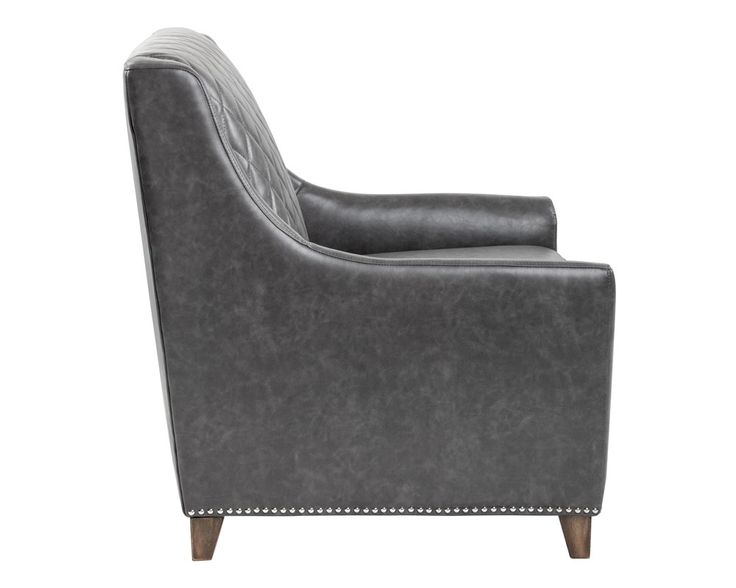BERGAMO ARMCHAIR   ASH GREY LEATHER   The classic quilted design of this armchair makes it a perfect addition to a library or office. Stocked in ash grey bonded leather with silver nailhead, and chestnut brown and black bonded leather with antique gold nailhead.